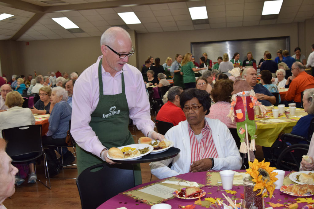 Rob Johnson serving Thanksgiving Meal
